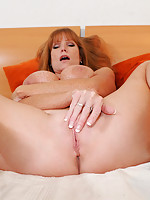 Horny Darla Crane gets wild in bed as she stuffs her fingers in her hungry pussy